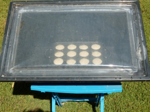 Mini cheese cakes baking in the SOS Sport solar oven