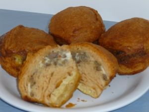 Breakfast biscuits stuffed with egg and sausage baked in a solar oven