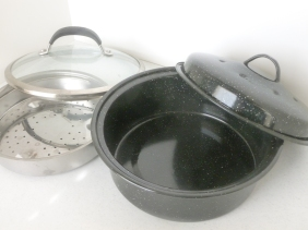 Dark pot with lid, glass lid, steamer basket used in solar cooking